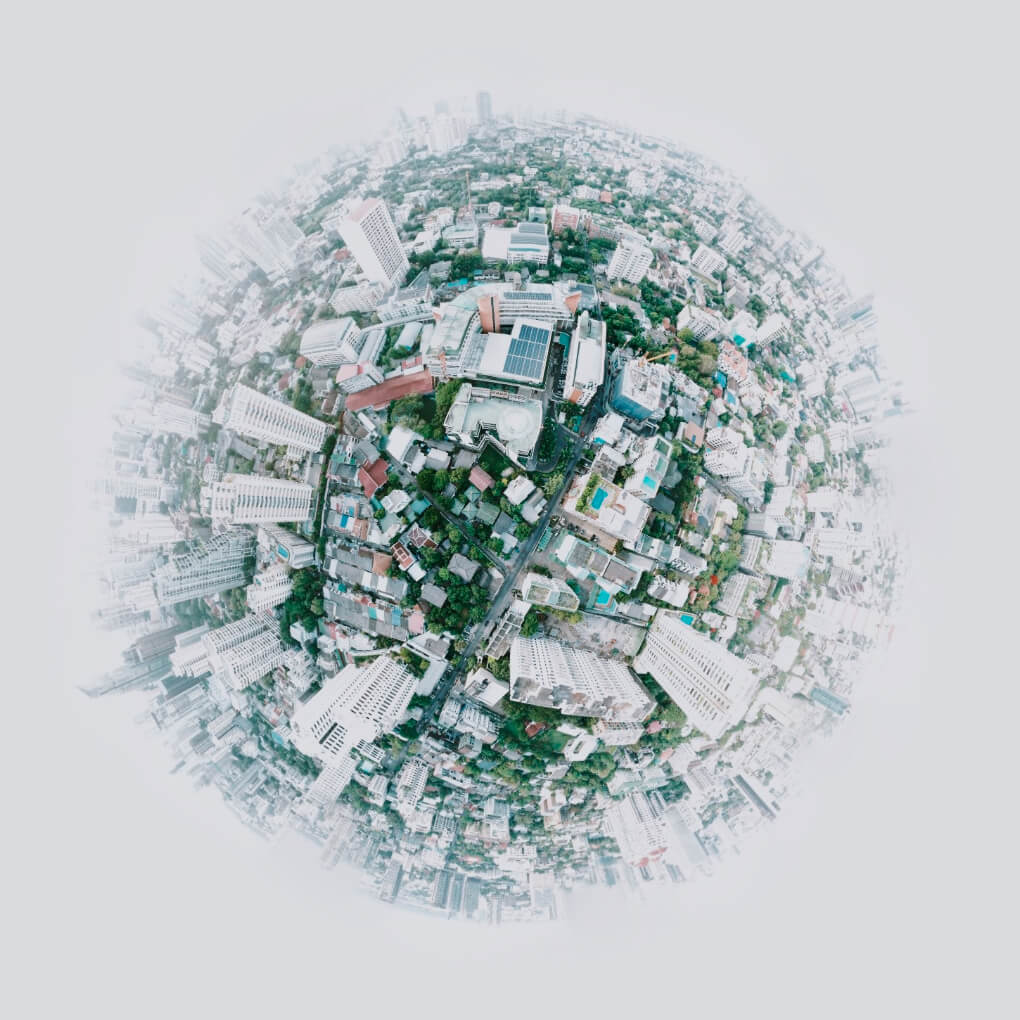 Cityscape in the shape of half globe, slowly rotating.